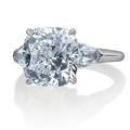 Three stone diamond ring with trapezoids